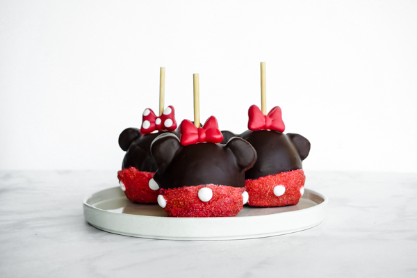 Minnie Mouse Chocolate Covered Caramel Apple // magicaltreatsathome.com